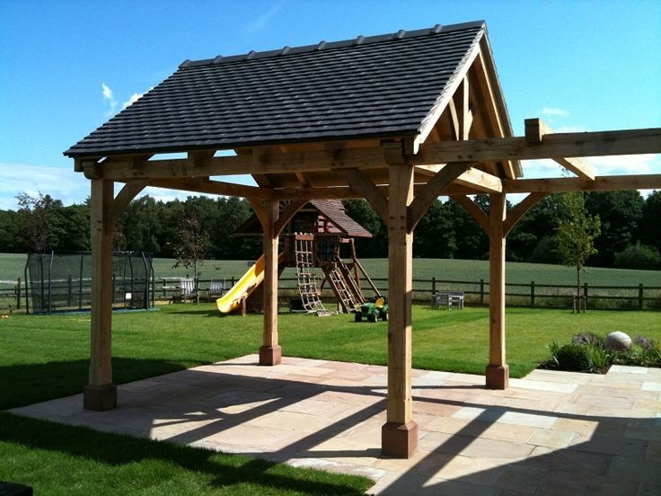New, bespoke oak gazebo & pergola - designed by Elizabeth Buckley who also commissioned the red Cheshire sandstone 'staddle stones' from a local stone mason