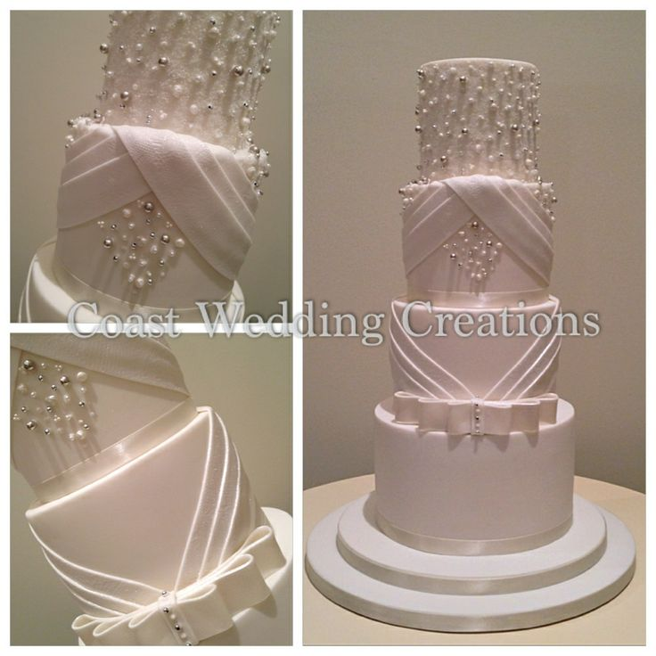 Tall 4 tier white wedding cake embellished with pearls and crystals. To view more if our cakes pop over to our site www.coastweddingcreations.com.au