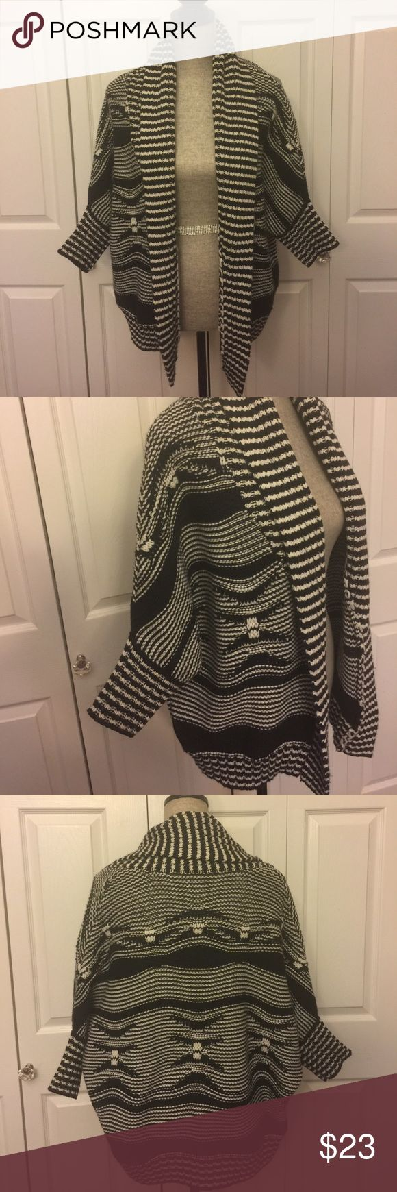Express Oversized Black and White Tribal Cardigan Super cute and chunky oversized tribal print Express Cardigan. In great used condition! No tears or stains! Express Sweaters Cardigans