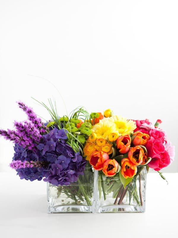 """I AM glad I didn't go with the """"rainbow theme"""" for the flowers for our wedding but... I certainly haven't ruled out this idea for baby showers, birthday parties, etc. ROYGBIV Flower Arrangement- how could you not love this?!"""