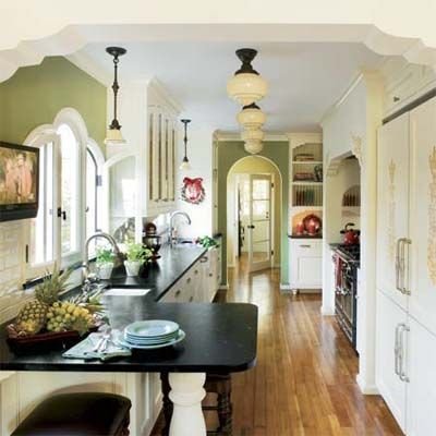 spanish galley kitchen.  I am so in love with this, love the honed black countertops.  This would be perfect in a spanish bungalow in the historic phoenix district.
