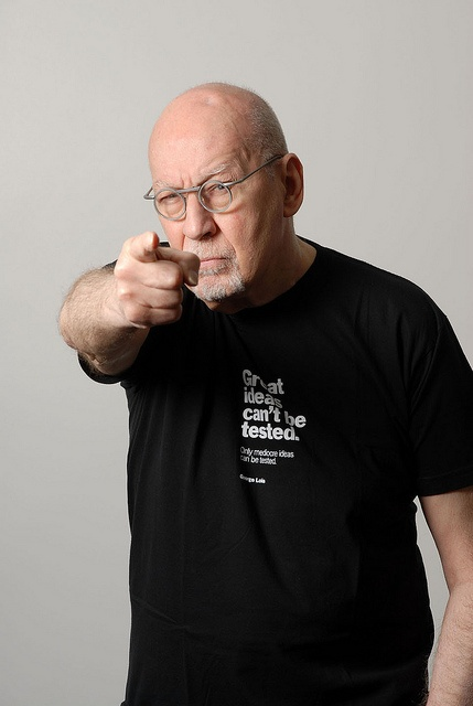 """George Lois wearing a shirt I designed for TypographyShop. George christened our line of his quips and quotes The Ten Commandments of George Lois.  It reads: Great ideas can't be tested. Only mediocre ideas can be tested."""" From his groundbreaking work at Doyle Dane Bernbach to his controversial Esquire covers, George Lois has carved a career sans equal in the advertising industry. A portion of the proceeds will benefit the Herschel Levit scholarship fund at Pratt, Mr. Lois' alma mater."""