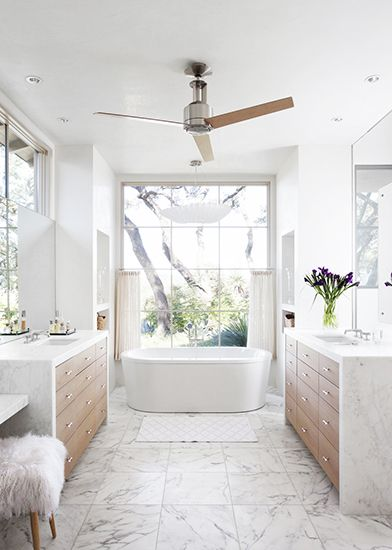 Home Tour: Tasteful and Timeless in Austin// fur stool, modern bathtub, marble floor