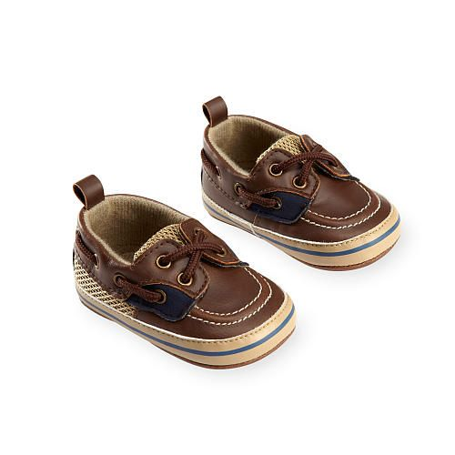 He'll be ready for adventure in these Koala Baby Boys Brown/Beige Lace Up Soft Sole Boat Shoes, a Babies'R'Us exclusive! Classic lace-up style is designed with contrast piecing for a cute preppy look. Soft outsoles provide flexibility for his developing feet. <br><br>Koala Baby Boys Brown/Beige Lace Up Soft Sole Boat Shoes features:<br><ul><li>Includes a pair of soft sole boat shoes</li><br><li>Classic lace-up styling</li><br><li>Soft sole provides flexibility</li><br><li>Made from man-made…
