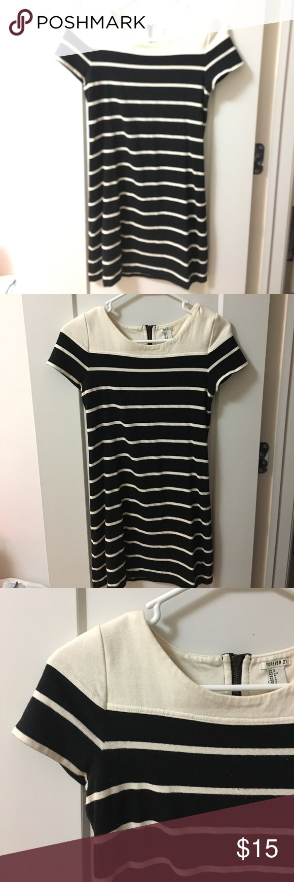 Striped Nautical inspired mini dress w/ cap sleeve Black and white/cream horizontal striped mini dress with visible back zipper design. Very flattering and cute. Good, thick material for Forever 21 and in excellent quality. I love wearing this dress in the summer with a cute floppy hat. Forever 21 Dresses Mini