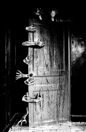 Bizarre And Creepy Photography, zombies finally getting into the room. from the potential victims point of view. shot in black and white to put emphasis on the dark 'reality' of the situation. Everything in the picture looks very static bar the hands. scary mood.