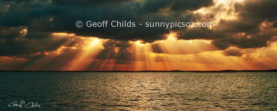 Crepuscular rays sunset screensaver colourful by GeoffsSunsetPics, $3.75