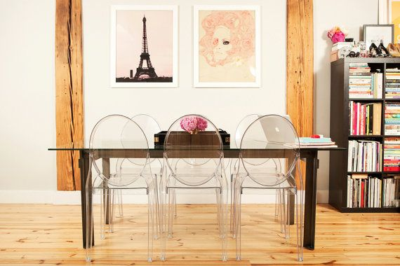 I love the look of the Lucite chairs with the dark table