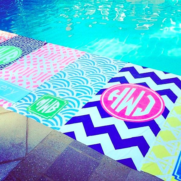 Monogrammed pool towels as party favors for a bachelorette pool party!