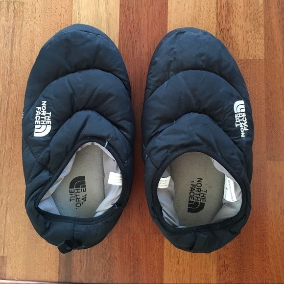 North Face Black Down Slippers These comfortable black north face slippers will keep your feet warm! I have a size 9 women's foot and they fit with room. North Face Shoes Slippers