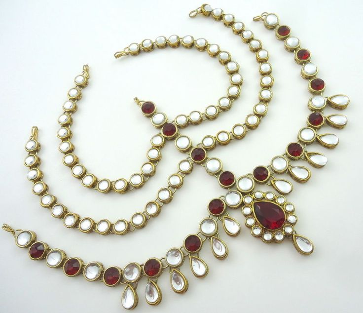 Maroon cz kundan gold tone indian bollywood matha patti hair accessory jewelry. Traditional Look Exquisite Gold Plated Matha Patti Studded With Crystal Cz Kundan. * Actual color of the product may vary due to computer screen resolution.