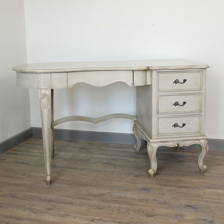 Paris Range - Ornate Cream Dressing table / Desk / Writing Table Beautiful ornate distressed cream dressing table desk Finished with a gorgeous curved design to the table top  and fabulously carved legs and antique style brass handles Cleverly designed with three drawers for extra storage www.melodymaison.co.uk