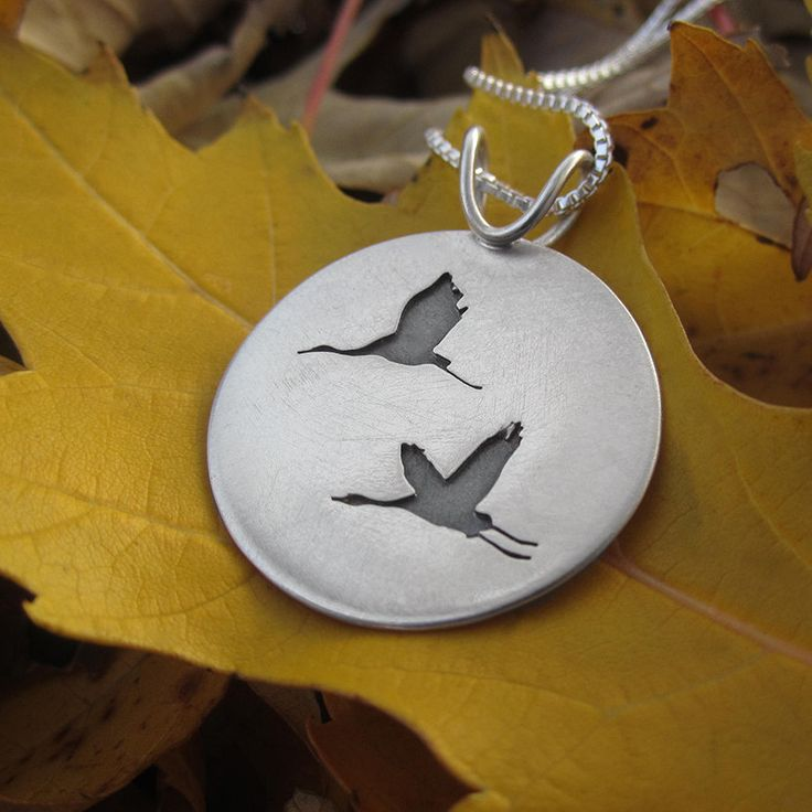 This handcrafted sterling silver pendant is inspired by the elegance of the Sandhill Crane in flight. Their annual winter migration always brings a sense of nostalgia while watching their flight south