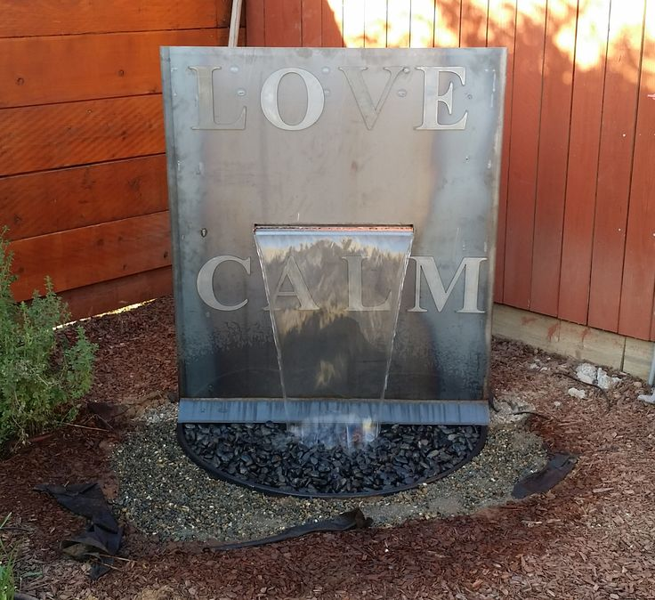 My talented husband made me this water feature. Metal letters from Metal Mart connected with magnets.