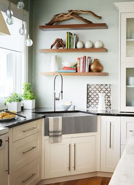 "In this Chicago ""smart kitchen,"" clever features add up to one user-friendly sink area. Tall pots and vases fit under the high faucet spout; a magnetic docking system guarantees the hand spray locks in place. An apron-front sink made of stainless steel won't rust, stain or chip. Its zero-radius design (meaning straight, not rounded, corners) maximizes usable space. Details: http://www.midwestliving.com/homes/kitchen-tour-smarty-plans?page=4"
