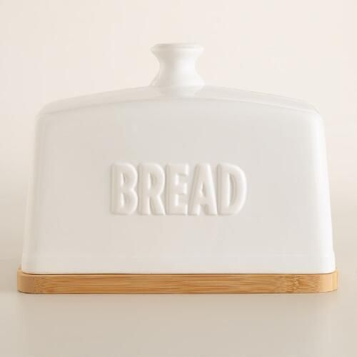 One of my favorite discoveries at WorldMarket.com: Ceramic Bread Box with Wood Cutting Board
