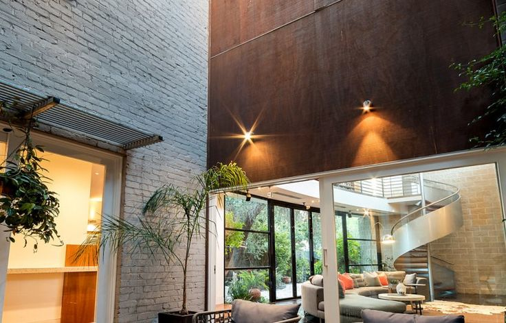 "Agent, Rick Daniel, told SCHWARTZWILLIAMS that this house was, ""A timeless design and vast open spaces define what is Fitzroy's most grand offering."" Set over three light-filled levels, bordered by Japanese-inspired courtyards and an internal tranquility pool, the home offers a versatile floor plan incorporating a living room with double-height ceiling, formal dining room, 'ship's prow' gallery and library, as well as a large studio or home office."