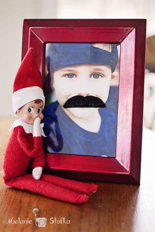 Mustache Mischief! Our family's Elf on the Shelf, Love Bug, is back and up to his old tricks again! Today he put mustaches on all of the Little's pictures! Want some more Elf on the She…