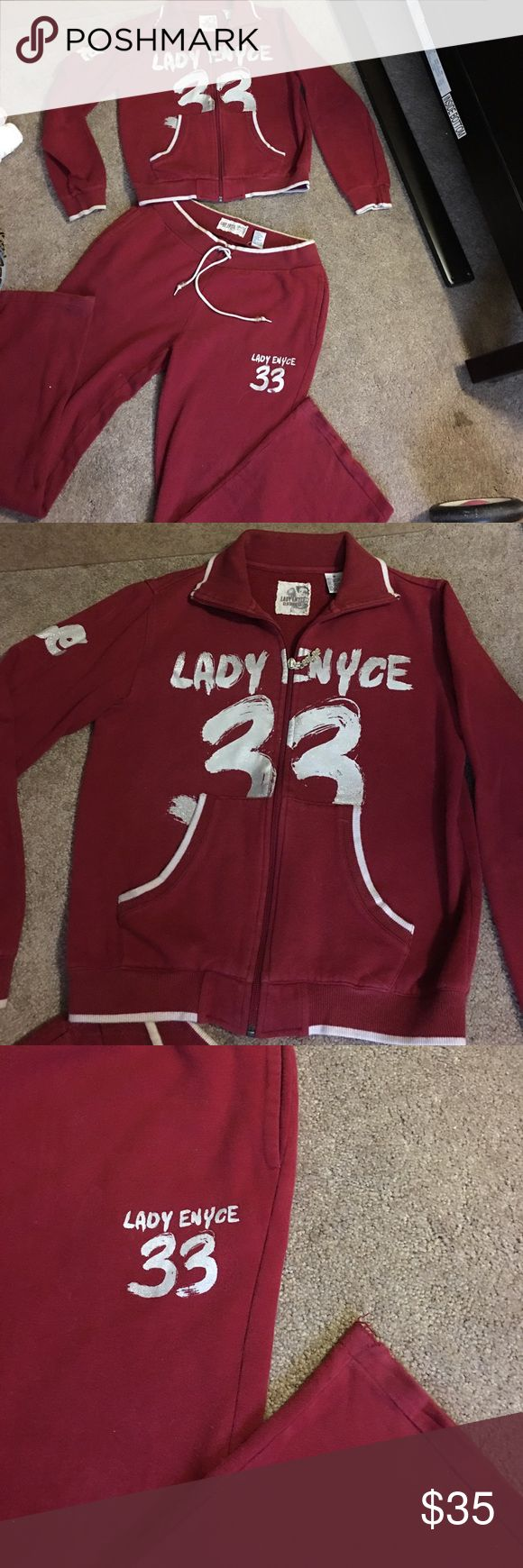 Lady Enyce sweatsuit Burgundy lady enyce jogging sweat suit . Very comfy and warm .. tiny tiny fraying on corner of bottom barely noticeable just felt the need to mention . Size medium ! lady enyce Other