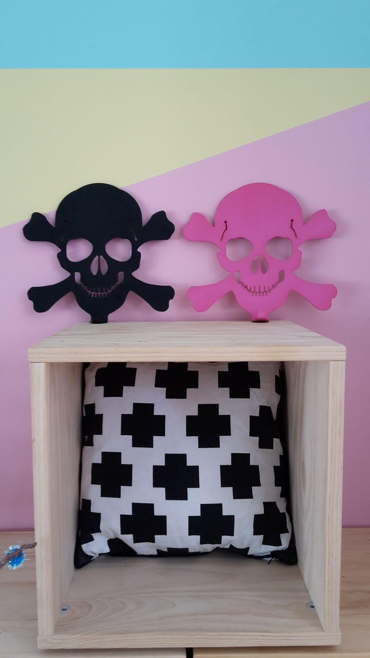 pink and black anodised aluminium skull coat racks
