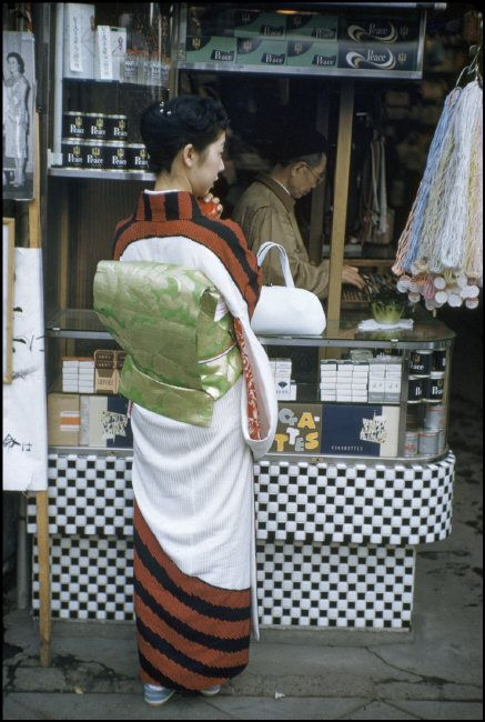 Woman in traditional kimono at a tobacco shop, Tokyo, Japan - 1958
