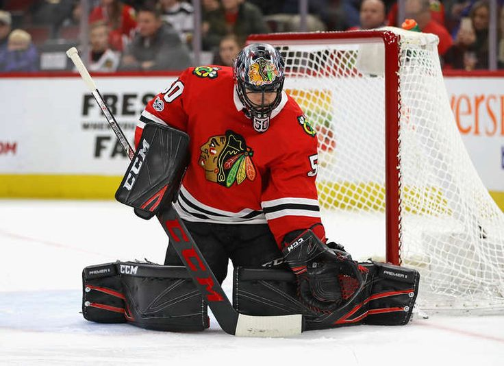 CHICAGO, IL - DECEMBER 08: Corey Crawford #50 of the Chicago Blackhawks makes a glove save against the Buffalo Sabres at the United Center on December 8, 2017 in Chicago, Illinois. (Photo by Jonathan Daniel/Getty Images)