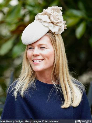 Autumn Phillips, daughter in law of Anne, Princess Royal, wears a rose colored beret with cabbage rose to EASTER Service at Sandringham. April 5, 2015 in Emily London | Royal Hats