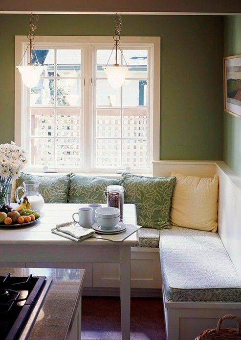 A cozy banquette outfitted with custom  cushions and throw pillows.