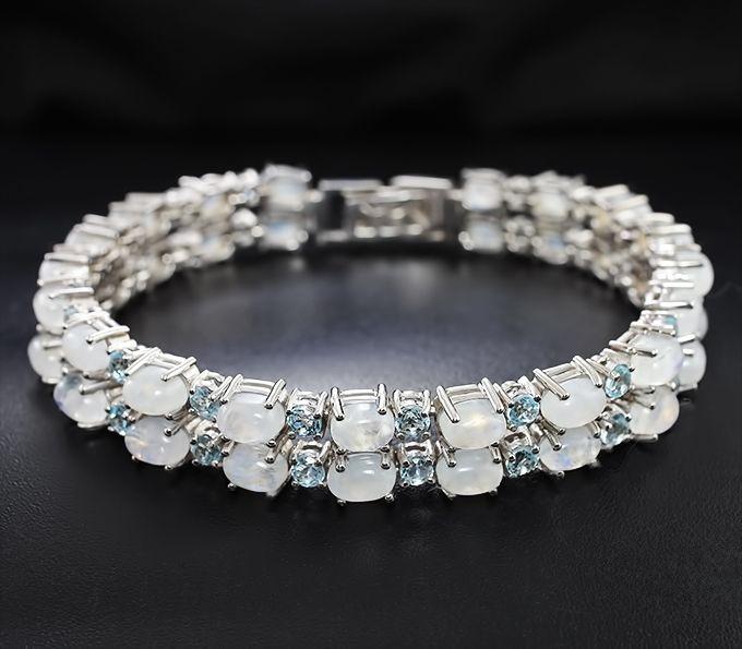 Серебряный браслет с лунным камнем и голубыми топазами Серебро 925