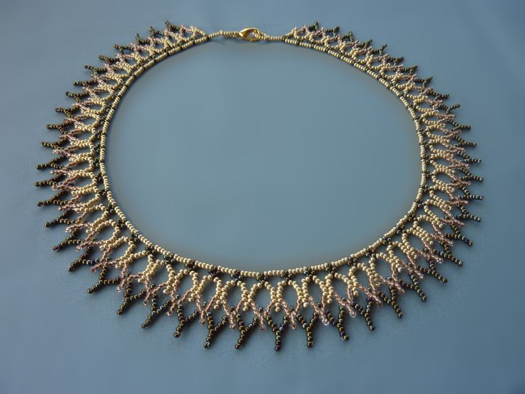 FREE beading pattern for necklace made entirely out of 11/0 seed beads resembling rows of cathedral windows.