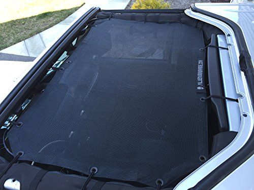 Alien Sunshade for Jeep Wrangler 2-Door or 4-Door - Covers Front. Just bought one, Will review once it arrives.... 1 yr later - I really like it. I almost always have it installed.  Can still pop the Freedom panels in and out. Provides great protection from sun yet you feel open!