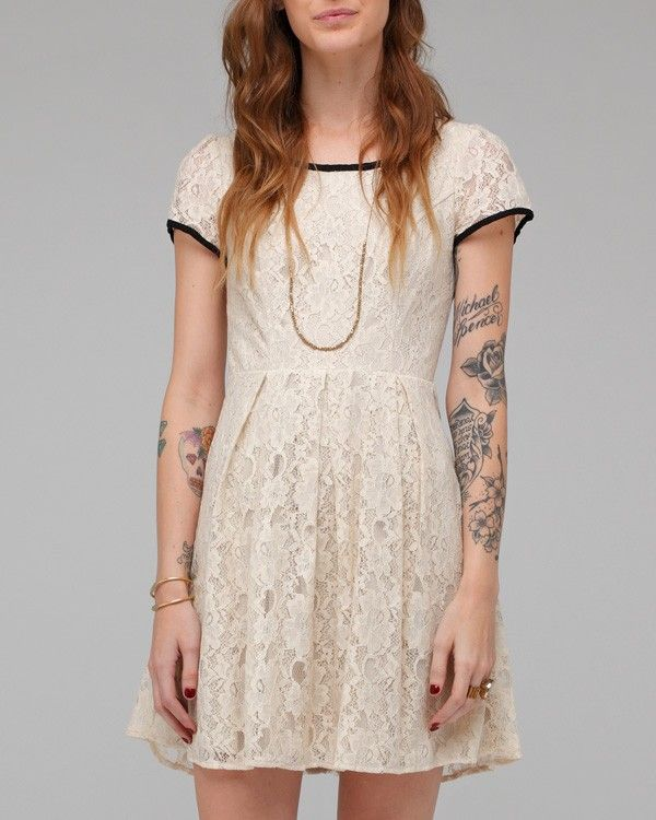Phoebe Tee Dress    Scoop neck lace tee shirt dress with front princess seams, collar and arm cuff contrast piping, and pleating around the waist. Fully lined.