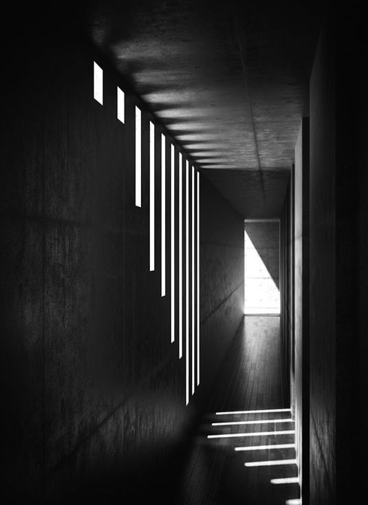 Tadao Ando lighting effects in concrete space create a moody environment, appropriate for an enclosed and private confession space.