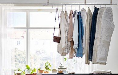 Hang your clothes from a curtain rail in the middle of the room and create a beautiful and unique room divider between a bedroom and home office space.