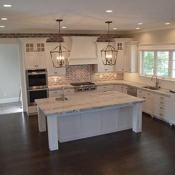 Classic Charleston Style Farmhouse Kitchen with brick backsplash, painted island and lantern pendant lights