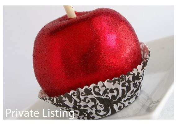Glittering chocolate covered apple.
