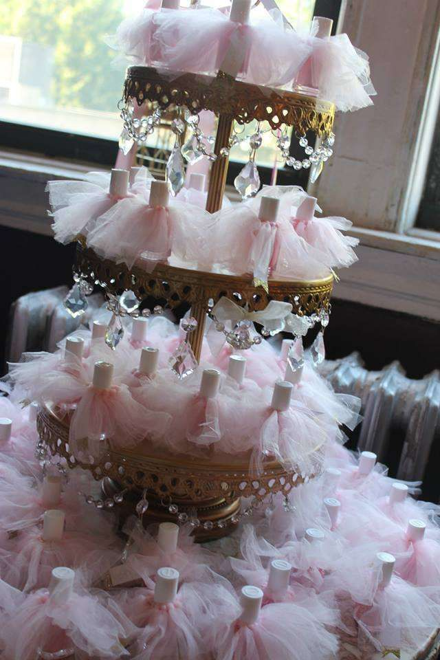 Dressed up favors at a pink and gold baby shower party! See more party planning ideas at CatchMyParty.com!