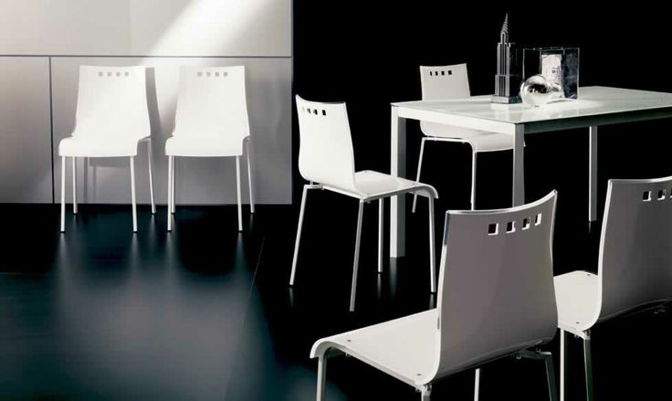 SMILE, design: Studio Ozeta   Metal frame stackable chair, Vitrex or wooden shell. www.ozzio.com