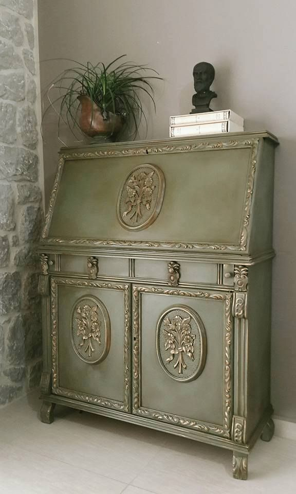 Artist Nick Vardakas of Artistic Paths is based in Greece and creates incredible work with Annie Sloan products. He used Chalk Paint®️️ by Annie Sloan in Olive and Arles with the stenciled designs done in Barcelona Orange. The raised ornamental moldings were highlighted with Annie Sloan Gilding Wax. The deepen the rich colors and create an aged look, Dark Chalk Paint®️️ Wax was used to finish the secretary. Beautiful!