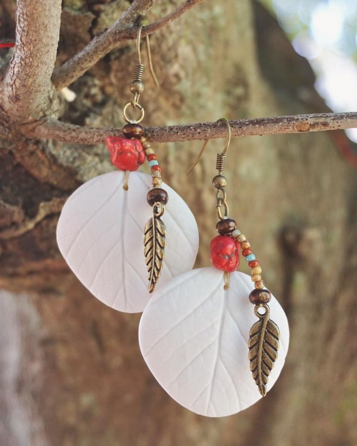 """Brand new Native American-Style Beaded Earrings - """"Summer Strawberries"""", just listed in my online shop (link in profile)!!! Handmade using Japanese and Czech seed beads, and my handmade Southern Ice Porcelain Strawberry Leaf Beads. Earrings are hand beaded together using a fine beige beading thread. Seed bead colours include: Picasso brown, red-brown opaque and turquoise. Other beads used: wood and red stone-like chips. Antique brass earring findings used: leaf charms…"""