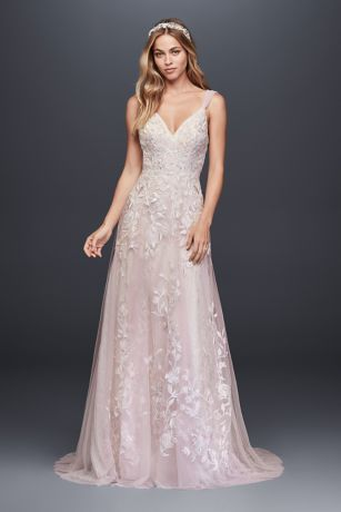 A dream dress for a true romantic, this ethereal tulle wedding gown from Melissa Sweet is embellished with 3D flowers, butterfly appliques, and dusty pastel embroidery. The look is completed with an a