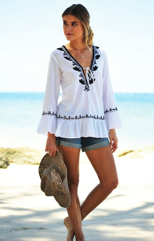 Coco Bay Embroidered White Tunic This beautiful embroidered black and white cotton summer tunic is a must for all holiday wardrobes. With pretty gathering round the sleeves and hem, this beach kaftan is feminine yet relaxed and can be dressed up or down. Delecate Black embroidery round the neck, hem and sleeves finish this beautifully.