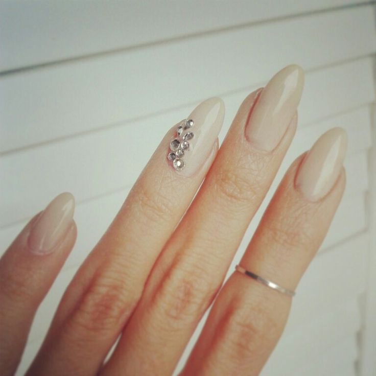 Almond nails nude and gems. Love these ❤