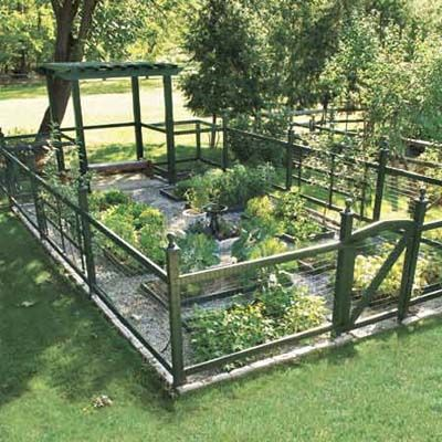 The 576-square-foot plot produces veggies all summer for a family of four, with plenty left over to share. Tidy raised beds and gravel paths make it easy to care for, and evoke an English country garden.