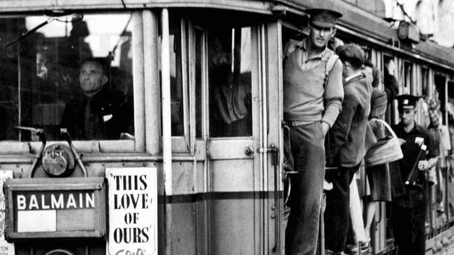An overcrowded tram leaves Railway Square in Sydney heading for Balmain in 1946. v@e.