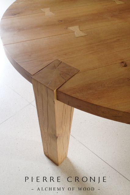 A Pierre Cronje French Oak Trio table at the Delicatessan at Tokara - Wine and Olive Farm. The butterflies are a method of construction and just happen to be a beautiful detail too.