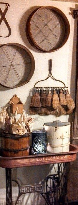 ~antique whisk brooms on garden rake~ ~red wagon on top of old sewing machine base~ ~Wooden & wire sieves~!  <3