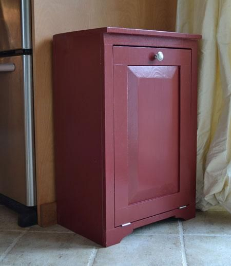 DIY tutorial for a tilt-out trash bin. I would like 2 built side-by-side, finished in white with a black top so it coordinates with our kitchen. One could be trash, the other, recycling. The top would hold a incoming/outgoing mail system as well as a fruit bowl, etc. Yet another project for my husband and sons to tackle together :)