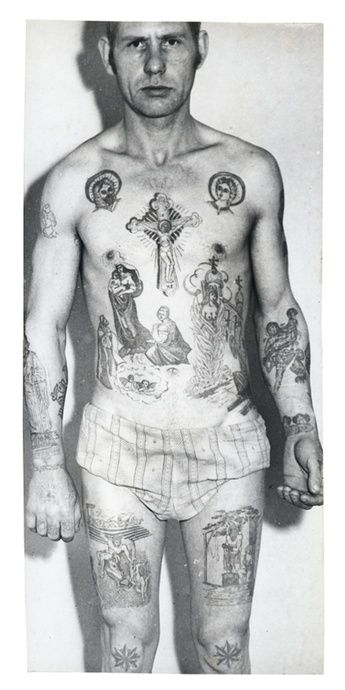 On the thigh a hooded executioner with an axe stands above a half-naked woman, a common tattoo on persons convicted of the murder of a relative (or relatives). Its secondary meaning is 'Death to traitors'. The naked woman being burnt on a cross symbolises a conviction for the murder of a woman. The number of logs can denote the number of years of the sentence. The naked woman entwined in a snake on the forearm refers to the ancient story of the serpent-temptress...
