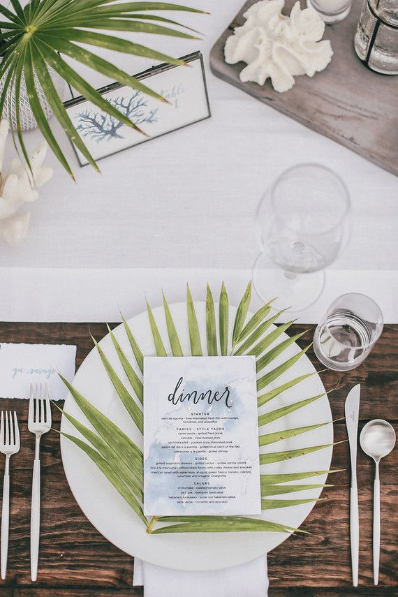 Palm frond place setting. | Photo by Max Wanger; Coordination & Design by Bash Please; Floral Design by Moon Canyon Design